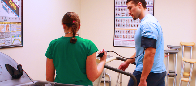 a physical therapist helps a client