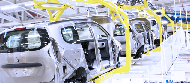 cars are carried on an assembly line