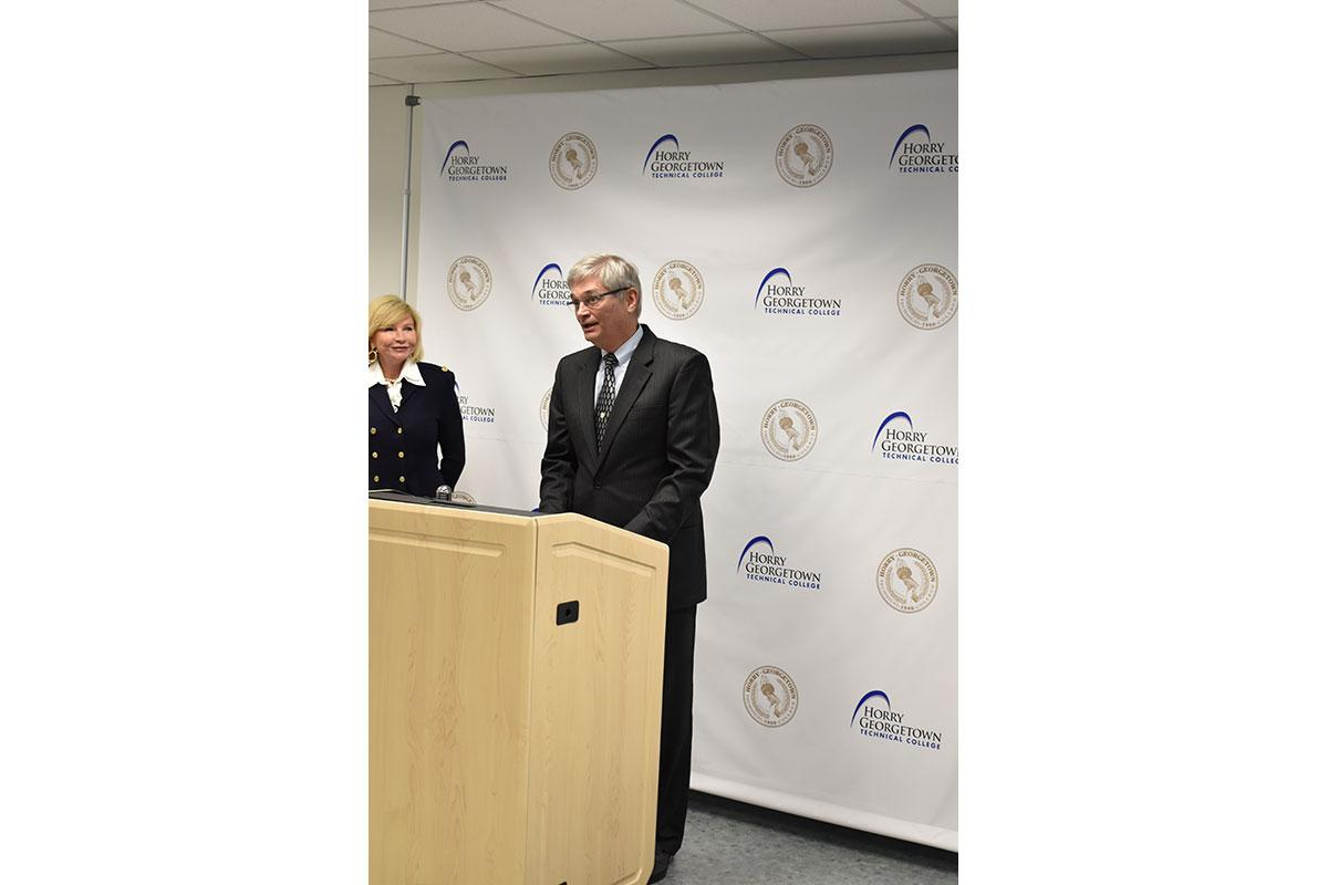 Horry-Georgetown Technical College President Dr. Marilyn Fore looks on as Professor Stan Greenawalt discusses the details of a $750,000 cybersecurity grant with the Office of Naval Research and an educational partnership with Space and Naval Warfare Systems Center Atlantic.